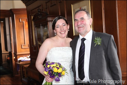 The bride and her father at Castle Stuart, Inverness, Highlands. in the Drawing room before her wedding.