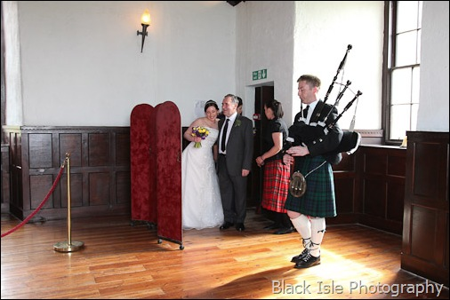 The wedding party in the Great Hall at Castle Stuart Highlands