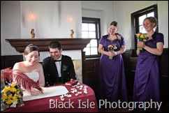 Signing the register during the Wedding ceremony at Castle Stuart Inverness in the Highlands