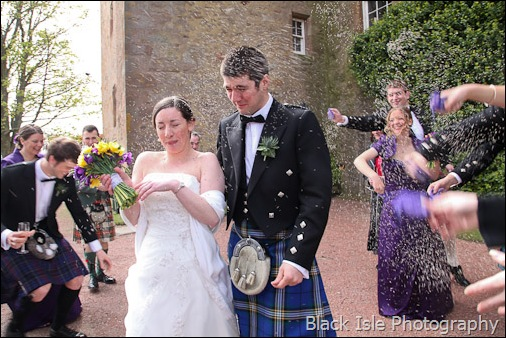 Throwing confettii after the Wedding ceremony at Castle Stuart Inverness in the Highlands