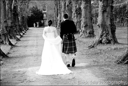 The Bride and Groom in the gardens after the Wedding ceremony at Castle Stuart Inverness in the Highlands