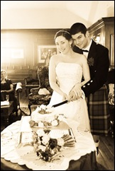 Cutting the Cake at Becky and Stuarts wedding at Castle Stuart in the Highlands