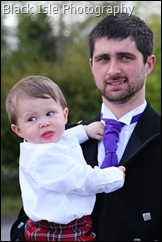 Wedding photograph of the groom with his son at Loch Carron in the Highlands