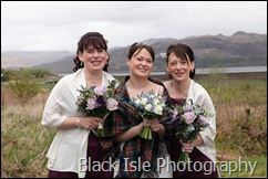 A photograph of the wedding party at Loch carron in the highlands