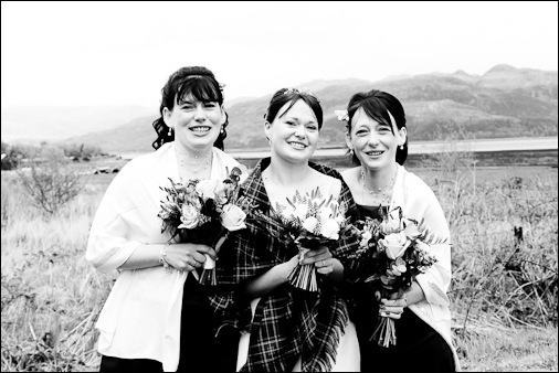 A black and white photograph of the bride and bridesmaids at her wedding at Loch Carron in the Highlands