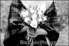 A bride and her flowers at the wedding in Loch Carron in the Highlands.