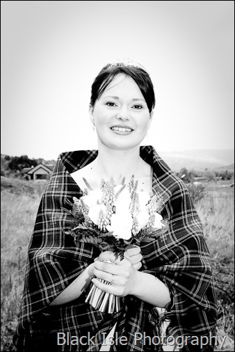 A wedding photograph of the bride at Loch Carron in the Highlands