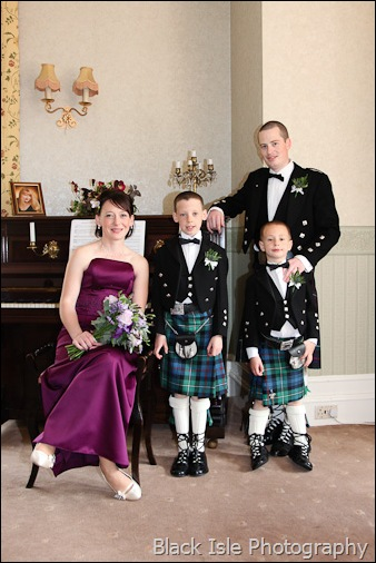 A wedding photograph the bridesmaid and her family at Ledgowan Lodge Hotel highlands