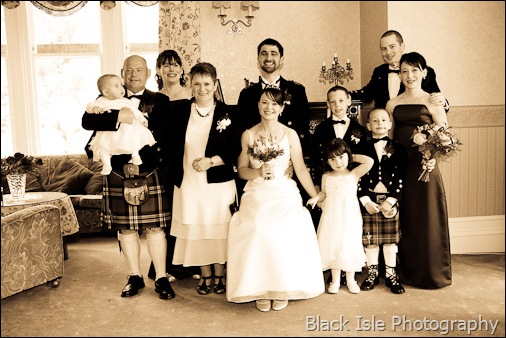 A wedding group photograph at Ledgowan Lodge Hotel Highlands