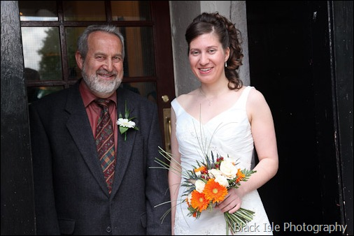 A photograph of the bride and her father at a highland wedding