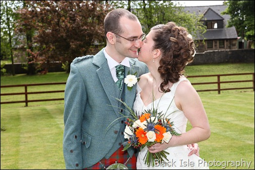 Aphotograph of the bride and groom at a highland wedding