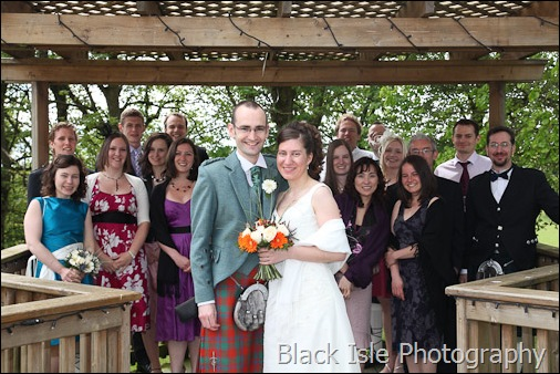 A photograph of the bride and groom and friends at a highland wedding