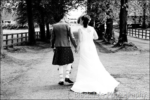 A Black and white photograph of the bride and groom at a highland wedding