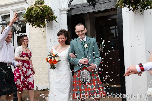 A photograph of the bride and groom at a highland wedding